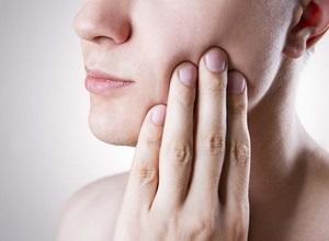 dente infeccionado rosto inchado